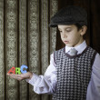 Stock Photo: Child in vintage clothes hold letters a b c