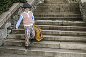 Exterior stairs and child with vintage bag — Stock fotografie