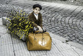 Child on a road with vintage bag — Stock Photo