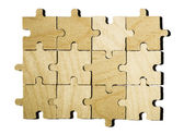 Wooden puzzle on white background. — Stock Photo