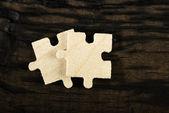 Wooden puzzle on dark background.  — Stock Photo