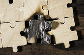 Burning wooden puzzle on dark background. — Foto de Stock