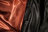 Shiny black and red satin fabric — Fotografia Stock