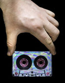 Hand holding vintage cassette tape — Stock Photo
