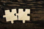 Wooden puzzle on dark background.  — Stock Photo