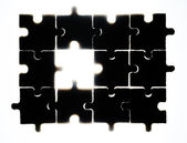 Wooden puzzle and backlight background — Foto Stock