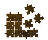 Wooden puzzle and backlight background — Stock Photo