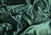 Shiny green satin fabric — Stock Photo