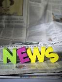 Word news on newspaper — Stock Photo