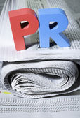 Word PR on newspaper — Photo