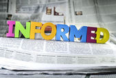 Word informed on newspaper — Stock Photo