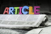 Word article on newspaper — Stock Photo
