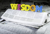 Word wisdom on newspaper — Stock Photo