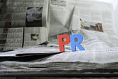 Word PR on newspaper — Stock Photo