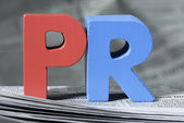 Word PR on newspaper — Stockfoto