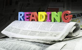 Word reading on newspaper — Stock Photo
