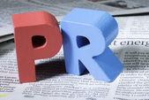 Word PR on newspaper — Stock Photo