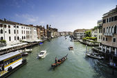 Ancient buildings and boats in the channel in Venice — ストック写真