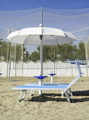 Sunbeds and umbrellas on the beach — Stock Photo