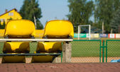 Chairs and football goal, the city stadium — Stok fotoğraf
