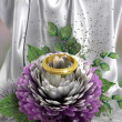 Holiday and wedding background with chrysanthemum and ring — Stock Photo