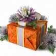 Holiday flowers with gift box on isolate white — Stock Photo