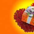 Holiday flowers with gift box on isolate white - Stock Photo