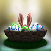 Decorated Easter eggs on the grass in basket — Stock Photo