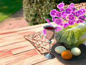 Jewish celebrate pesach passover with eggs, matzo and flowers on nature background — Stock Photo