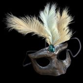 Metal carnival mask with feathers on isolate black — Stock Photo