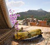 Ancient architecture with sunbed and scroll concept tourism vacation background — Stock Photo