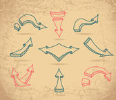 Set Sketch arrows on beige grunge background — Stok Vektör