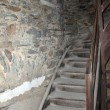 Wooden staircase and stone wall — Stock Photo #23231272
