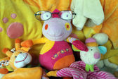 Bright children's plush toy in glasses — Stock Photo