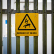 Sign on fence danger of death — Stock Photo #22123707