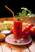 Tomato juice on table — Stock Photo