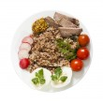 Buckwheat on plate — Stock Photo