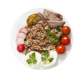 Buckwheat on plate — Stock Photo
