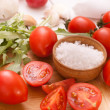 Chopped tomatoes with arugula — Stock Photo #24219935