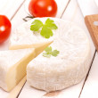 Stock Photo: Brie on white table