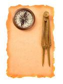 Kompass und teiler auf papier — Stockfoto