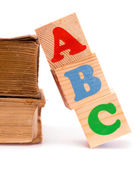 Alphabet letter ABC blocks for kids and old books — Stock Photo