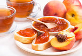 Peach jam on bread horizontal — Stock Photo