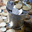 Pail of world coins — Stock Photo