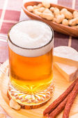 Beer with various snacks — Stock Photo
