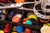Box of varios buttons — Stockfoto