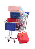 Gift boxes on grocery cart — Stock Photo