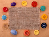 Sackcloth with various button — Stock Photo