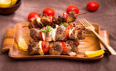 Barbecue meat on skewers — Stock Photo