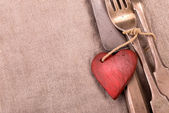 Silverware and red wooden heart — Zdjęcie stockowe